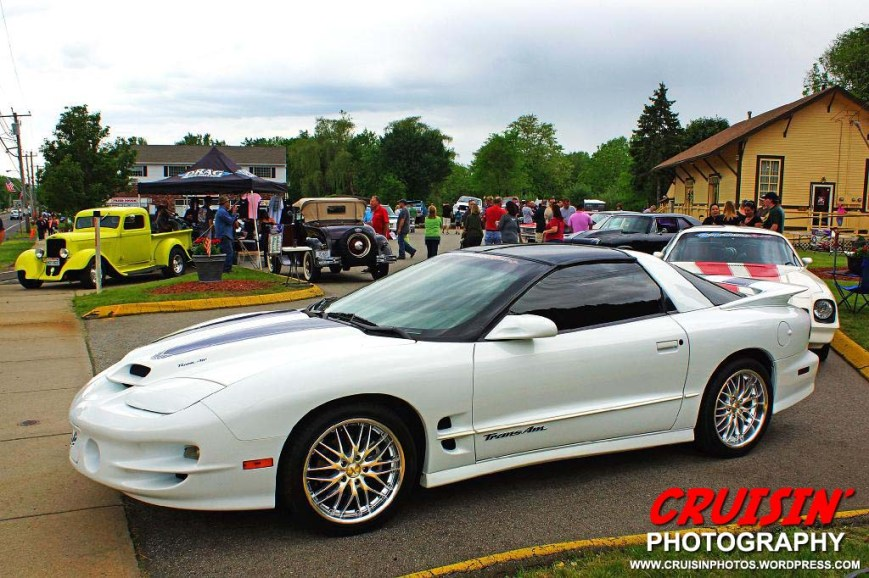 The Johnson Realty parking lot is a hive of activity during the Second Annual Cromwell Memorial Day Car Show.