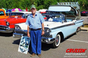 Middletown's Burt Hirsch poses with his unusual 1959 Ford Skyliner Retractable.