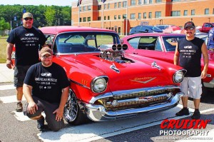 The American Muscle Car Club founding members – Paul Wolfer (kneeling), Tito Lorenzo (left) and Rob Lorenzo (right) –surround Tito's 1957 Chevy Bel Air, which is powered by an 1,100hp, supercharged 454ci big block V8 engine.