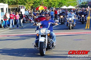 A wave of bikers arrive at the 9th annual Motorcycle Mania.